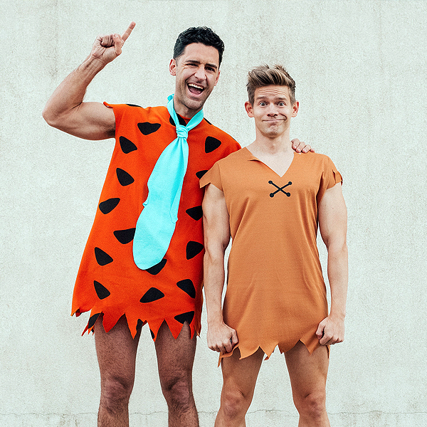 Two men dressed up as Fred Flintstone and Barney from 'The Flinstones'