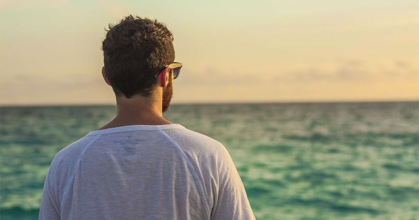 Man looking to the horizon. In honour of World Mental Health Day, we've compiled a small list of some easy ways to look after your emotional wellbeing.