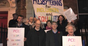 Protesters holding 'PCI: Stop bashing gays!' outside a Presbyterian Church meeting.