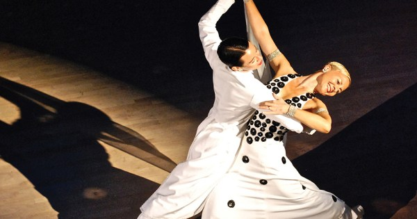 Two women dancing wearing all white, a great way to get fit in 2020