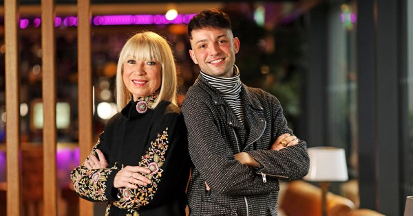 Anne Doyle and James Kavanagh stand back to back with their arms folded