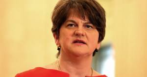 Arlene Foster, a middle aged woman with short hair wearing a fancy dress about to speak at an event