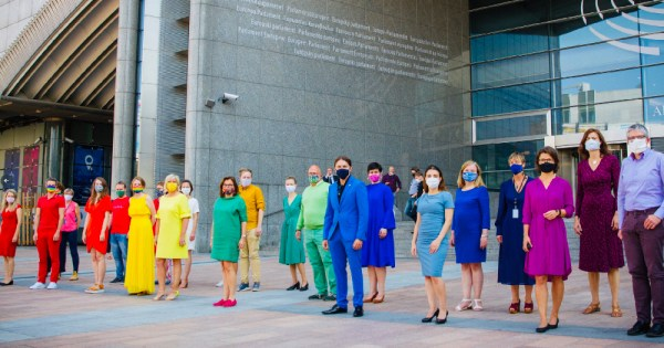 State of Union address. Members of the LGBTI Intergroup for MEPS create a rainbow flag with their clothes outside the European Commission