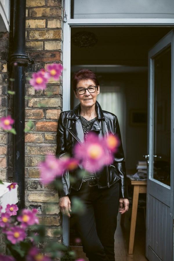 life in lockdown feature portrait of woman standing at her door