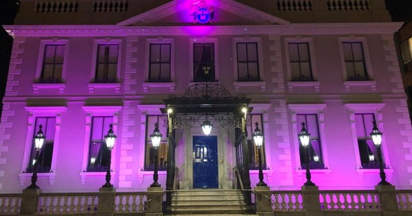 Exterior shot of Mansion House up-lit in Purple to mark International Intersex Solidarity Day
