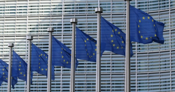 a row of EU flags, EU new strategy for LGBTQ+ equality