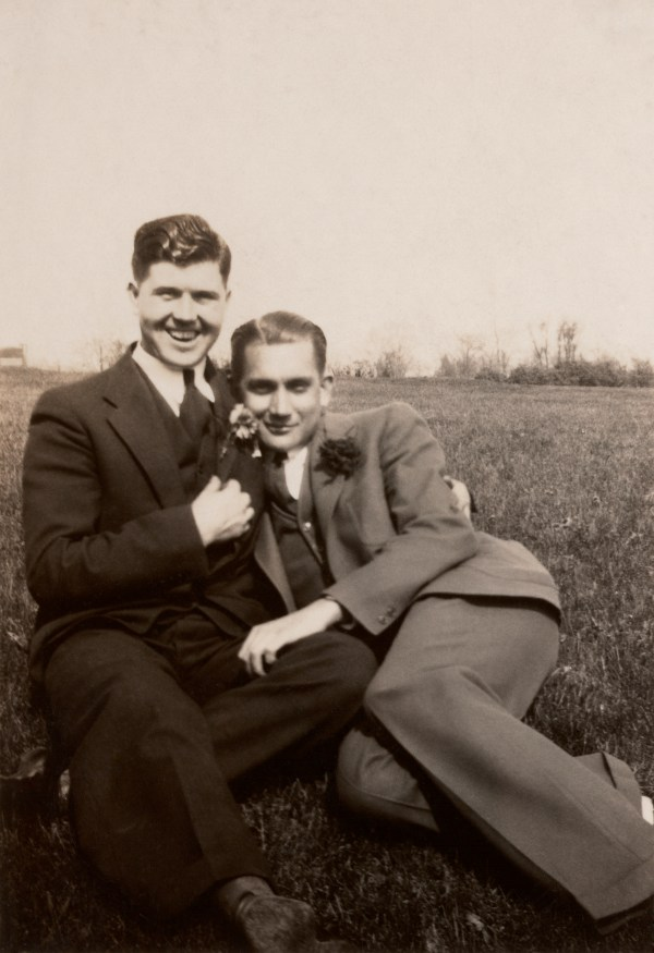 two men in suits with their arms around each other