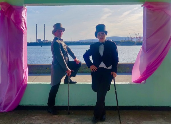 two gentlemen pose by the sea side. Piece from mash mash exhibition, queer happenings this week