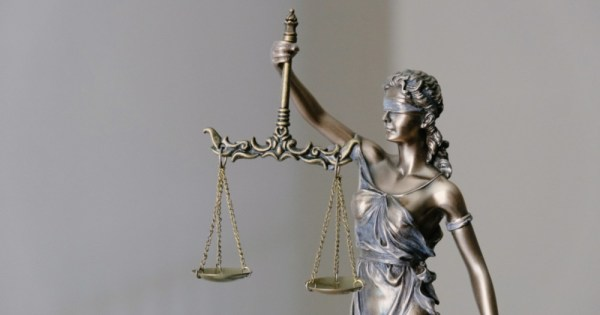 lady justice holding the scales, overturn ban on conversion therapy