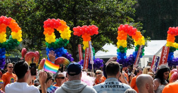 Pride spelled out in rainbow balloons, queer slang explained