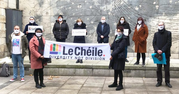 """Members of Le Chéile alliance holding a banner that reads """"diversity not division"""""""