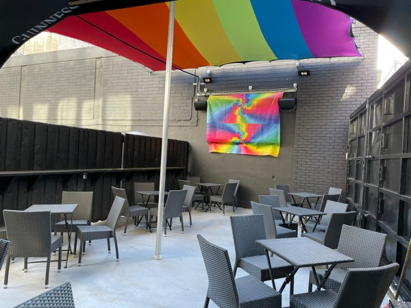Outside sitting area of The George with bacl seats and rainbow flags. The iconic gay bar will be reopening in June.