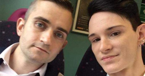 Two men posing for a selfie on a bus
