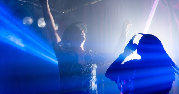 picture of Mother club DJs Rocky and Ruth bathed in stage lighting dancing to illustrate the comeback gig for opening weekend