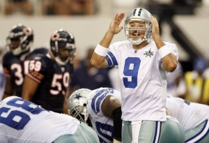 Cowboys quarterback Romo signals before the snap against the Bears in Arlington, Texas