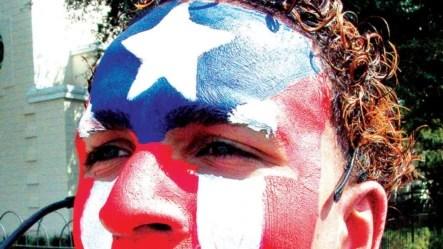 Un puertorriqueño luce la bandera de Puerto Rico pintada en su rostro en uno de los festivales boricuas en la ciudad de Orlando, Florida.