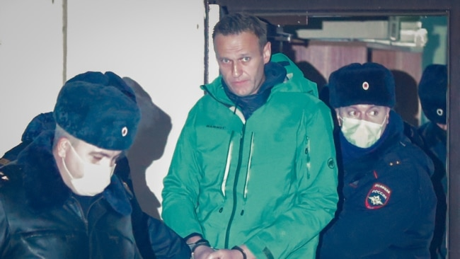 Detained Navalny Slams 'Lawlessness,' Calls For Protests