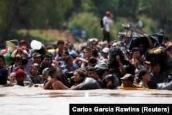 Migrants from Central America seeking to get to the USA, on the border of Guatemala and Mexico