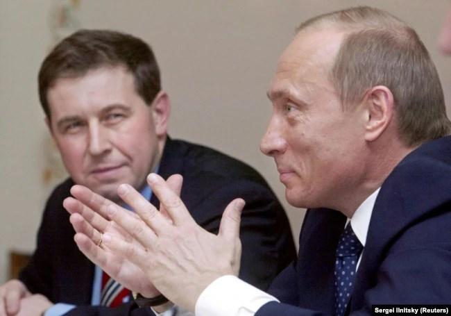Президент Росії Володимир Путін (праворуч) і його радник з економічних питань Андрій Ілларіонов. Москва, 9 квітня 2004 року