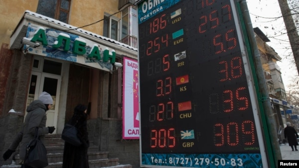 An exchange-rate board in Almaty reflects the fall of the Kazakh tenge on February 11.
