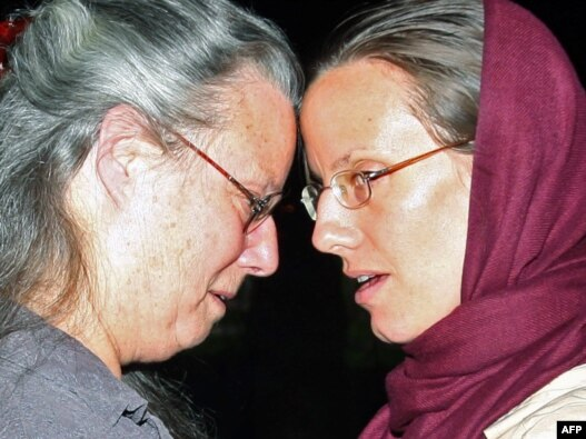 Sarah Shourd embraces her mother Nora upon her arrival in Oman after being released from Iran on September 14. Her two companions remain imprisoned in Tehran.