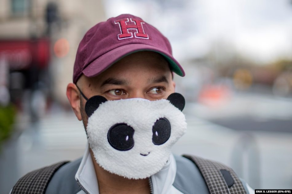 Alan Gordon wears a panda face mask while venturing out to go food shopping in Washington, D.C., on April 1.