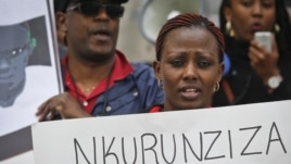 Burundi nationals from across the U.S. and Canada, along with supporters, demonstrate, calling for an end to atrocities, human rights violations in Burundi, outside U.N. headquarters in New York, April 26, 2016.