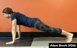 This core exercise is the advanced version of the Plank Pose. (VOA Learning English/Adam Brock)