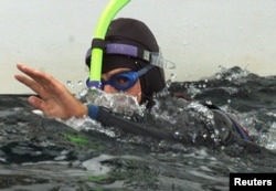 FILE - French swimmer Benoit Lecomte swims off the Brittany port of Quiberon at the end of his trans-Atlantic swim, September 25. Ben Lecomte left Cape Cod on July 16 to undertake the 5,400 kilometer swim aided by a yacht.