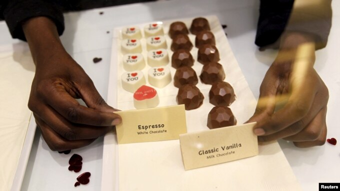 A sales worker arranges chocolate products inside the Absolute Chocolate shop in Kenya's capital, Nairobi, March 20, 2015.