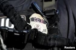 FILE - A U.S. Immigration and Customs Enforcement badge.