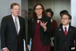 European Commissioner for Trade Cecilia Malmstrom, Japanese Minister for Economy, Trade and Industry Hiroshige Seko, right, and U.S. Trade Representative Robert Lighthizer are pictured prior to a meeting at EU headquarters in Brussels, March 10, 2018.