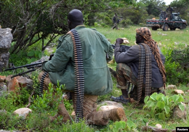 FILE - Soldiers from Somalia's Puntland keep guard on high grounds at the Galgala hills, during preparations for an offense against al-Shabaab militants, north of the capital Mogadishu, Jan. 9, 2015.