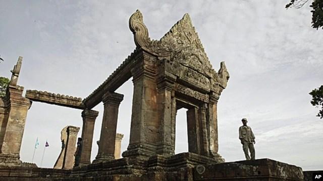 FILE - A Cambodian temple security guard stands at Preah Vihear temple, Cambodia.