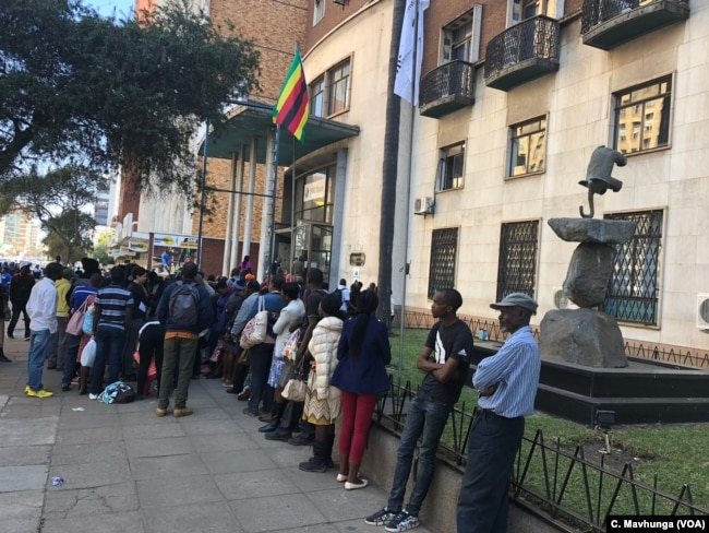 Bank queues For close to three years now, Zimbabweans spend hours to days in bank queues as cash shortages persist Harare, Sept. 10, 2018.