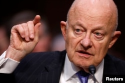 FILE - Former Director of National Intelligence James Clapper testifies about potential Russian interference in the presidential election before the Senate Judiciary Committee on Capitol Hill, Washington, D.C., U.S., May 8, 2017.