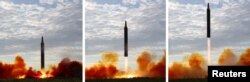 FILE - North Korean leader Kim Jong Un (not pictured) guides the launch of a Hwasong-12 missile in this undated combination photo released by North Korea's Korean Central News Agency (KCNA), Sept. 16, 2017.