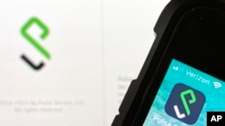 FILE - An icon for the Pulse Secure smartphone app, right, and a computer desktop info page are seen in Burke, Va., June 14, 2021. Suspected state-backed Chinese hackers penetrated the computer systems of critical U.S. entities by exploiting Pulse Connect Secure networking devices.