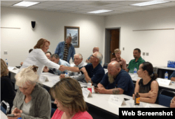 Democratic Sen. Heidi Heitkamp of North Dakota, left, in white, spoke recently to Valley City farmers and small-business owners at an economic roundtable.