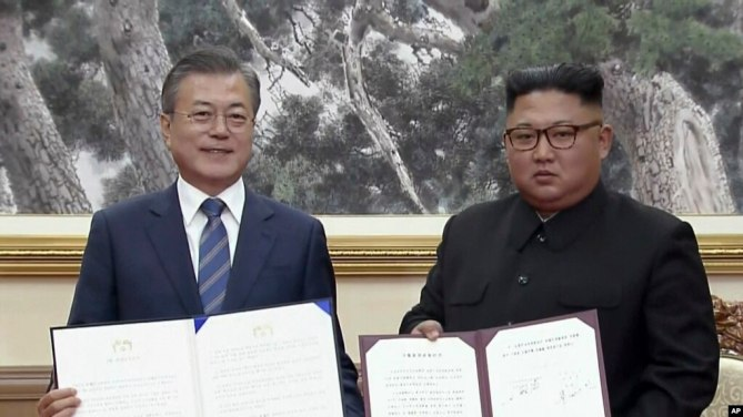 Image result for n. s koreas signed new agreements