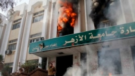 A man stands outside a faculty building at Cairo's Al-Azhar University after students stormed it on December 28, 2013.