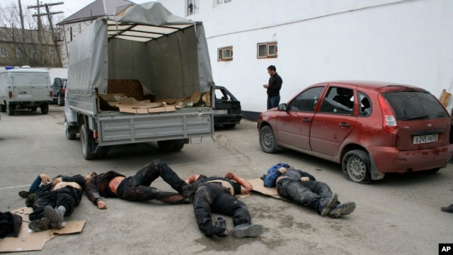 Bodies of four killed suspected militants are seen in Derbent region of Dagestan, April 18, 2011.