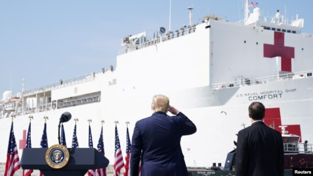 U.S. President Donald Trump salutes the crew of the Navy hospital ship USNS Comfort at Naval Station Norfolk, in Norfolk, Virginia, U.S. March 28, 2020.