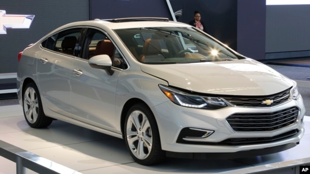 FILE - A Chevrolet Cruze is on display at the Pittsburgh International Auto Show in Pittsburgh, Pennsylvania, Feb. 11, 2016. General Motors, maker of the Cruze model, says consumer demand for the car in the U.S. has forced it to ramp up production in its plant in Ramos Arizpe, Mexico.