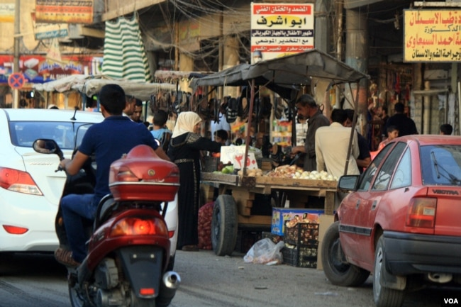 East Mosul was captured by Iraqi and coalition forces in January, and signs of recovery are evident in crowded shopping centers with increasing amounts of government electricity and water, July 9, 2017 in Mosul, Iraq. (H.Murdock/VOA)