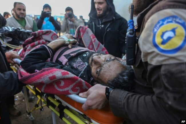 FILE - An injured Syrian arrives at a refugee camp in Rashidin, near Idlib, Syria, after he was evacuated from Aleppo during a cease-fire, Dec. 20, 2016.