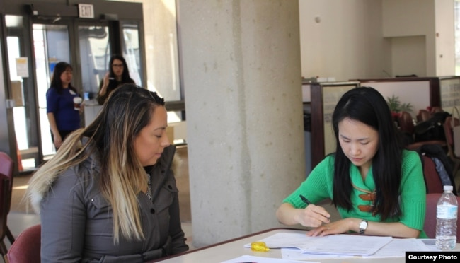 FILE - Green card holders attend a citizenship clinic in Rockville, Maryland. (Photo courtesy of AAJC)