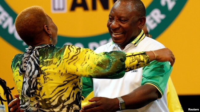 Deputy president of South Africa Cyril Ramaphosa greets an ANC member during the 54th National Conference of the ruling African National Congress (ANC) at the Nasrec Expo Center in Johannesburg, South Africa, Dec. 18, 2017.
