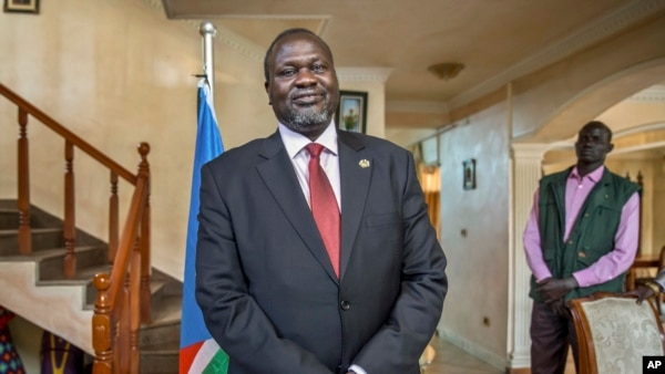FILE - South Sudan's rebel leader Riek Machar poses for a photograph as he is interviewed by The Associated Press about the situation in South Sudan.