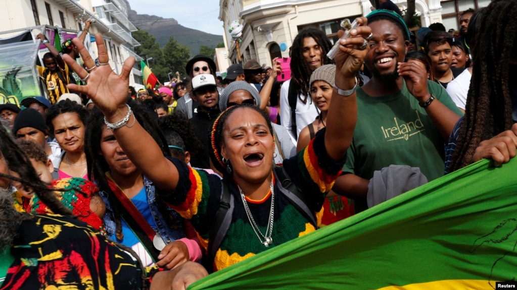 FILE - A protester carries a marijuana pipe during a march calling for the legalization of cannabis in Cape Town, South Africa, May 7, 2016. On Friday, Western Cape province's High Court ruled that marijuana can now be legally grown and smoked in the privacy of one's home.